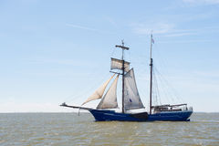 Clipper on Dutch wadden sea Royalty Free Stock Photo