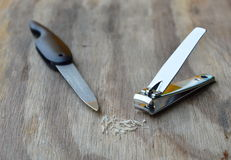 Clipper and nail file on wooden board Royalty Free Stock Photos