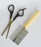 Clippers dog grooming  and comb on white background Stock Photography