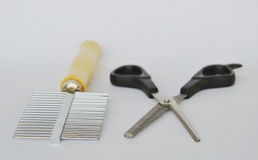 Clippers dog grooming  and comb on white background Royalty Free Stock Photography