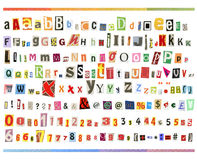 Clipping ABC. Big size clipping alphabet (cutout from newspapers and magazines) with numbers and symbols, isolated on white background Stock Images