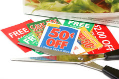 Clipping coupons. To save money at the grocery store Stock Photos