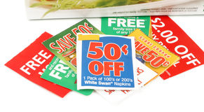 Clipping coupons. To save money at the grocery store Royalty Free Stock Image