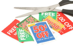 Clipping coupons. To save money at the grocery store Stock Image