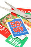 Clipping coupons. To save money at the grocery store Royalty Free Stock Photo