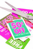 Clipping coupons. To save money at the grocery store Royalty Free Stock Photos