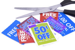Clipping coupons. To save money at the grocery store Stock Photography