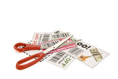 Clipping Coupons. A stack of clipped coupons with scissors on top on a white background Royalty Free Stock Photography