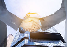 clipping path, Businessmen shaking hands on city background. Double exposure. coworker concept. stock photos