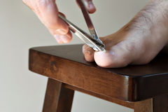 Clipping Toenails Stock Photos