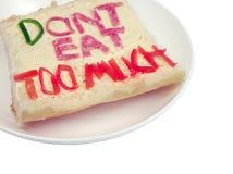 clippinguniversitetsläraren äter mycket banasmörgås t för Arkivfoton