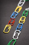 Clips. Lot Of Clips on black background Royalty Free Stock Photography