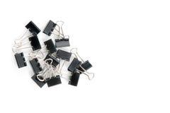 Clips de la carpeta/clips de papel aislados en blanco. Imagen de archivo