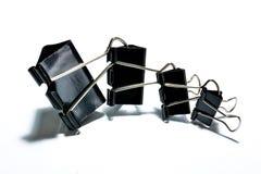 Clips de papel negros Fotografía de archivo libre de regalías