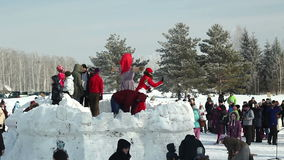 (2 clips) Folk fun - attack a snow fort, Russia Royalty Free Stock Photo