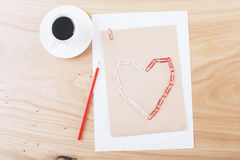 Clips heart on paper Royalty Free Stock Photos