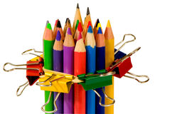 Clips holding on to the pencils Royalty Free Stock Images
