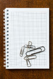 Clips on the notebook Stock Photography