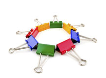 Clips for a paper. Multi-coloured clips for a paper, are combined in a circle-star, is removed on a white background royalty free stock image