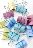 Multicolor clips on white background. Shot in studio Royalty Free Stock Photo