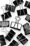 Black Clips on white background. Clips on white background shot in studio Royalty Free Stock Photography