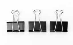 Black Clips on white background. Clips on white background shot in studio Royalty Free Stock Image
