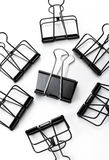Black Clips on white background. Clips on white background shot in studio Stock Photo
