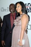 Clive Davis, Djimon Hounsou, Kimora Lee Stock Photography