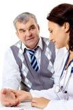 Clínico y paciente Fotos de archivo libres de regalías