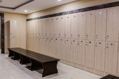 Cloakroom at the hotel or gym, wooden scales royalty free stock photos
