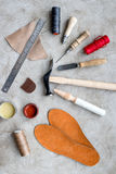 Clobber preparing his tools for work. Grey stone desk background top view Stock Photo