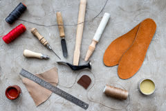 Clobber preparing his tools for work. Grey stone desk background top view Royalty Free Stock Photography