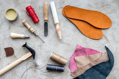 Clobber preparing his tools for work. Grey stone desk background top view Stock Image