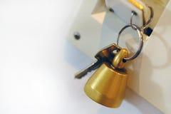 Cloche de porte et clés, maison bienvenue photo libre de droits