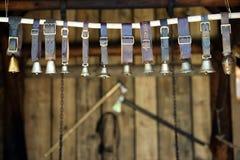 Cloches de bétail dans une rangée Photographie stock libre de droits