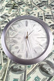 Clock on the 100 dollar banknotes Royalty Free Stock Photography