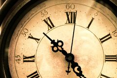 Clock. Old, stained, vintage clock closeup stock photos