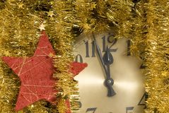 Clock. A clock with christmas decoration Stock Images