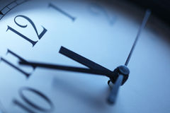 Clock. Closeup in blue tones Royalty Free Stock Photos