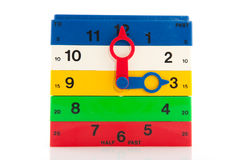 Clock. Colorful clock from blocs at three o'clock Stock Photos