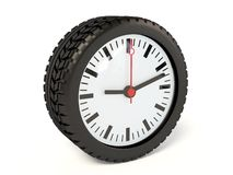 Clock. In tyre on white background Royalty Free Stock Images