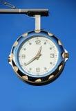 Clock. On a blue sky royalty free stock photos