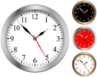 Clock. Wall clocks isolated over a white background Royalty Free Stock Photos