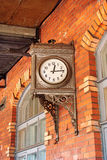Clock. On the platform of the railway station Shuvalovo. Russia Stock Photos