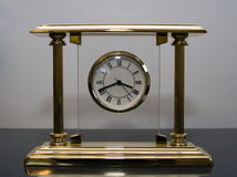 Clock. Beautiful golden clock. It costs few thousands dollars Royalty Free Stock Photography