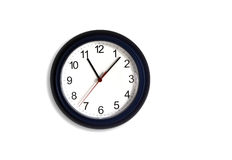 Clock. Hangs on the wall the circular electron clock Royalty Free Stock Photography