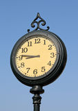 Clock. On the street on blue sky background Stock Photography