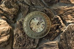 Clock. Antique clock on stone wall Stock Image