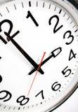 Clock. Office clock showing 3 o'clock Stock Photography