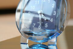 Clock. Quartz clock with blue transparent shell Stock Images